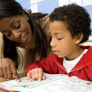 adult helping child, foster care tutoring, tutors, help with homework