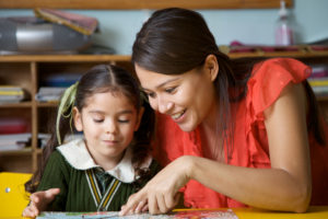 child getting help with homework, tutoring, foster care tutors, one on one tutor