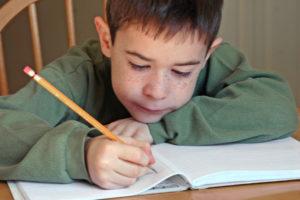 child doing homework, homework help, foster care, foster care tutors